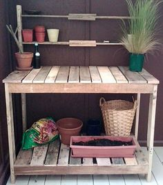 garden workbench made from a pallet I'd want a [covered] cut-out for a litter-box sized bin to hold my potting soil.  eh