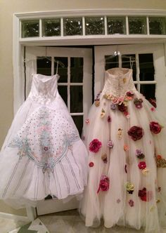 Repurposed wedding dresses= puffy paint and hot glued flowers  Got the dresses at a dress auction for charity it was fun.