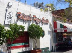 """Filippi's Pizza Grotto, Little Italy, San Diego ~ Outstanding food & atmosphere; you can write on your wine bottle & hang it from the ceiling! Our """"engagement bottle"""" is still there!"""