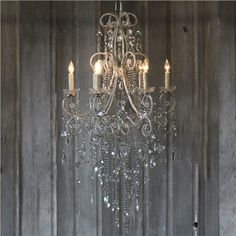 """The gorgeous Mirabelle is a sparkling reflection of itself in cascading glass macaroni swags, crystal accents and mixed specialty drops. Add timeless glamour to high ceilings with this impressive chandelier. Handmade in the USA, the mindful attention to detail and craftsmanship by the artists can be seen and felt in the finished fixture. Due to its custom nature, this order is a final sale. Chandelier measures 29""""W x 52""""H. Antiqued silver finished frame. Includes canopy and 3' chain. Accepts…"""