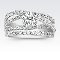 This spectacular wedding set makes a bold statement with 77 round pavé-set diamonds at approximately .78 carat total weight, set in a quality 14 karat white gold split shank setting. This incredible diamond ring awaits a dazzling center diamond of your choice.