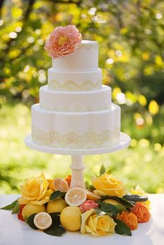 Wedding Cake with yellow lace and simple single coral flower - different height 4 tier