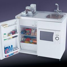 The popular John Strand Mini Kitchen has been sold throughout the UK for over 30 years used in a wide variety of residential and commercial situations. Tiny House Village, Shed To Tiny House, Tiny House Design, Small House Plans, Micro Kitchen, Compact Kitchen, Cute Kitchen, Shed Interior, Van Interior