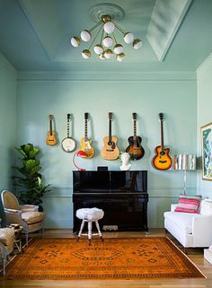 If you collect certain items that are taking over your place — like guitars — consider hanging them up as fun wall art alternatives. It'll definitely give guests something to talk about. Source: Brittany Ambridge for Domino