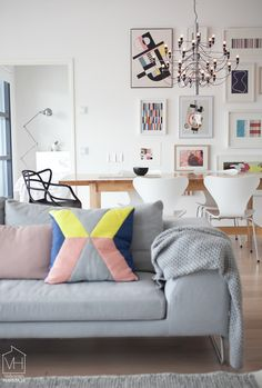 Wow! Love this colourful modern living room | Graphics | IKEA PS cushion | Gallery wall