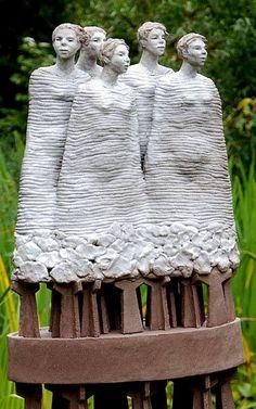 Garden sculpture five women by sculptress Hanneke van den Bergh