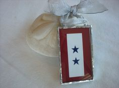 Seeing as our first (married) Christmas will be spent apart while he's deployed, I'm thinking of getting this (with one star) as our ornament for 2011. $22 on Etsy.