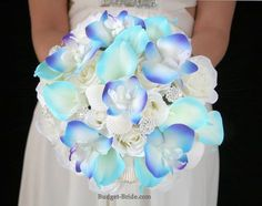 Blue calla lily and blue orchid beach theme bouquet with seashells and brooches.  Perfect for a destination wedding.  Silk wedding flowers at their finest.
