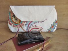 Makeup case cotton embroidered by NeedlesOfSvetlana on Etsy