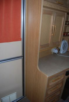 This unit in a van has had a panel covered in wood patterned sticky vinyl. Try our range of d-c-fix® woodgrains