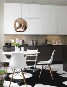 Cowhide rug, copper pendant, white & black kitchen, tulip table, eames chairs