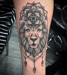 Lion tats.