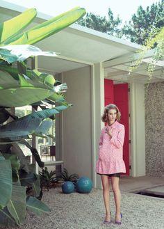 Pink door, pink coat.