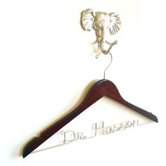 Wondering what to give as a medical school graduation gift?  A personalized hanger for the new doctor's coat is the perfect idea!  This wood hanger is customized with the doctor's name and makes a unique and thoughtful medical school graduation gift.