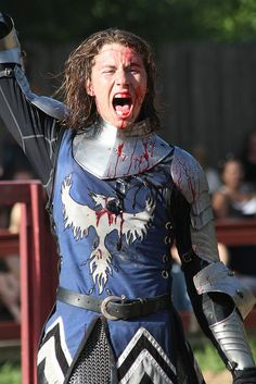 A gory win by quinn.anya, via Flickr (brown blond, blood, blue tunic, armor, sword, pheonix)