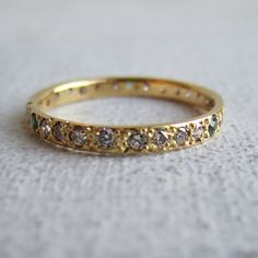 eternity band with diamonds and colored sapphires    --imagine in rose gold with peach colored sapphires instead of green
