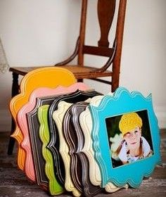 Buy the wood plaques at Hobby Lobby for $1, paint and mod podge your photo onto them.. I am so in LOVE with this idea! I so want to do this!