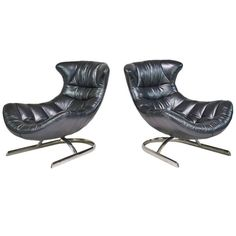 Pair of Futuristic Leather and Chrome Lounge Chairs | From a unique collection of antique and modern lounge chairs at https://www.1stdibs.com/furniture/seating/lounge-chairs/