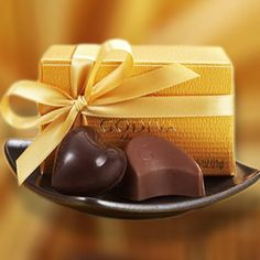Gold Party Favor - Proof that good things come in small boxes. Includes a Milk Chocolate Praline Crescent and Dark Chocolate Ganache Heart from our Godiva Gold Collection, completed with a gold ribbon. Perfect as a wedding or party favor for lovers of fine chocolate.