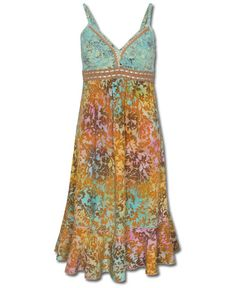 With warm and cool colors, this sundress is like watching the sunrise paint its canvas of color over ocean waters. Add the romantic crocheted empire waist with ribbon trim, stunning batik pattern, and slightly ruffled bottom and this summer dress is truly unforgettable!