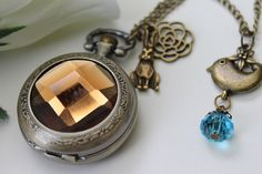 *Alice in Wonderland - Antique Brown Transparent Crystal Cover Pocket Watch Necklace - I'd love an owl rather than a rabbit on this one, wonder if she would swap charms...