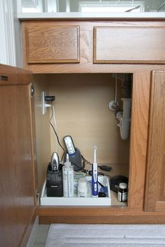 Install an outlet under the sink to keep hair dryer (or other unsightly necessities) plugged up and stored out of sight!