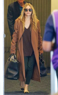 Ashley Olsen from Celeb Airport Style  The fashion designer zips through the terminal at LAX in comfortable cap-toe flats. A cozy oversized coat like the stylish traveler's tan topper can double as a blanket during a flight.