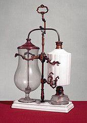 An antique balance siphon coffee maker