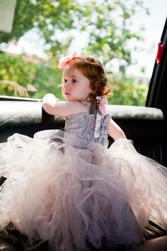 Adorable flower girl awaiting her big moment