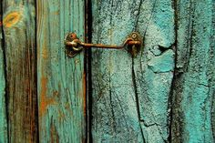 the detail in the colours and textures of the wood, paint, metal and rust is beautifully vibrant~~makes me want to go out and paint all the fence posts with Turquoise paint. Door Knockers, Door Knobs, Door Latches, Old Doors, Windows And Doors, Peeling Paint, Foto Art, Rustic Charm, Wabi Sabi