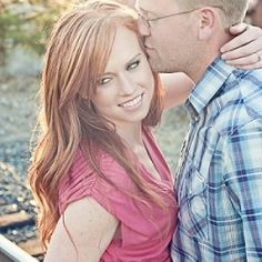 A rustic outdoor engagement session with a beautiful barn and a stunning red head!