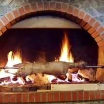 Traditional roast lamb on a spit made in country grill house in Slunj, Croatia