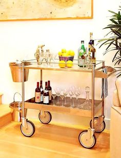 Gold bar cart... I also like this one, not sure what will go better in my space