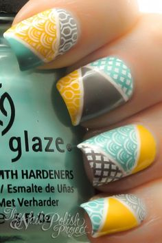 Geometric, taped, stamped nails with brown, teal, yellow, and white