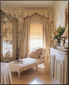 Love the mirrors on the armoire painted with flowers from the wallpaper.