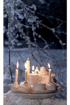 opaque white candle holders creates a wintry scene in the snow or not.
