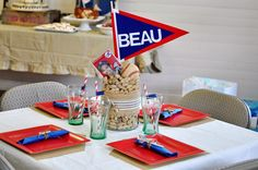 Centerpiece for boy baby shower. I like the idea of peanuts, animal crackers, and cracker jacks for circus theme.