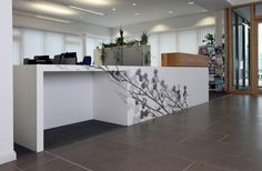 Reception desk made from Corian® Glacier White with sublimated pattern.