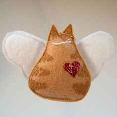 Hey, I found this really awesome Etsy listing at https://www.etsy.com/listing/170548450/angel-kitty-ornament-orange-tabby