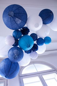 A wedding by the sea: a blue and white lantern sky