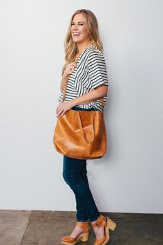 The Abera Crossbody Tote can be worn over the shoulder, or across your body, and is the ideal size to function as your work bag or as your everyday purse. It features an interior pocket and a magnetic closure.