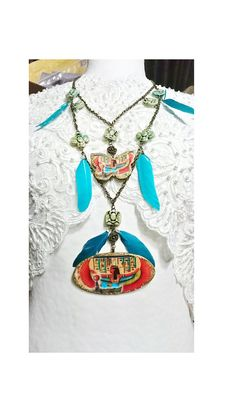 bcdfbdda1d9b Long necklace, Isis mother goddess of Ancient Egypt, wife of Osiris  surrounded by hieroglyphics