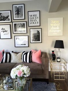 Brown couch with pink twin throw pillows