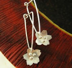 Another lovely version of the sakura earrings - these thread through handmade earwires that hang securely in your ears. Tiny silver dots are soldered on top of the handcut flowers. Very sweet and just in time for spring. A wearthou original. Sakura blossoms are 3/8 (1cm) in diameter.