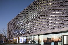 Nantong Urban Planning Museum by Henn Architekten. Seven types of metal panels vary from 9% to 90% closed.
