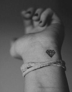 Tiny diamond wrist tattoo