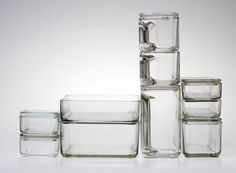 Wilhelm Wagenfeld studied metalwork at the Bauhaus between 1923 and 1925, where he designed a table lamp that became one of the school's most popular products. After leaving the Bauhaus, he went on to design a number of popular consumer products, among the most successful of which was Kubus, the modular glass storage containers he created in 1935. Made of heat-resistant industrial glass,