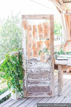 Wedding seating chart ideas - rustic, outdoor, wood, names, setting {Sycamore Tree Photography}