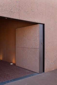 Entrance door - Memorial Rivesaltes in France by Rudy Ricciotti, Passelac & Roques architectes