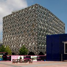 New tile-covered campus for Ravensbourne College of Design and Communication, located on the Greenwich Peninsula in London by Foreign Office Architects